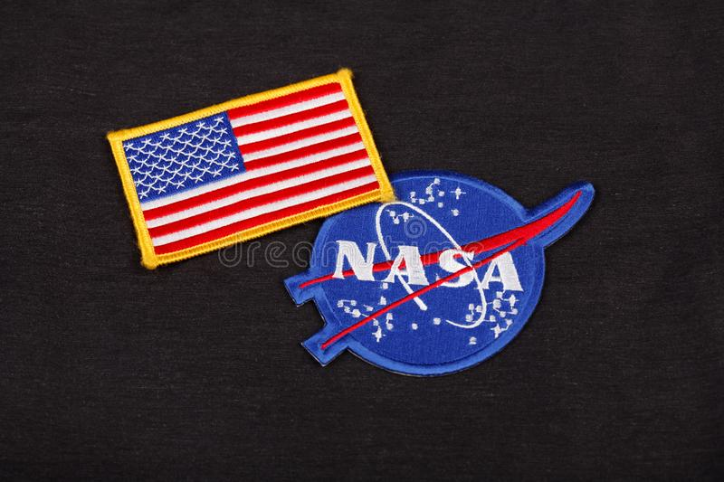 15 March 2018 - The National Aeronautics and Space Administration (NASA) emblem patch and US Flag patch on black uniform royalty free stock photo