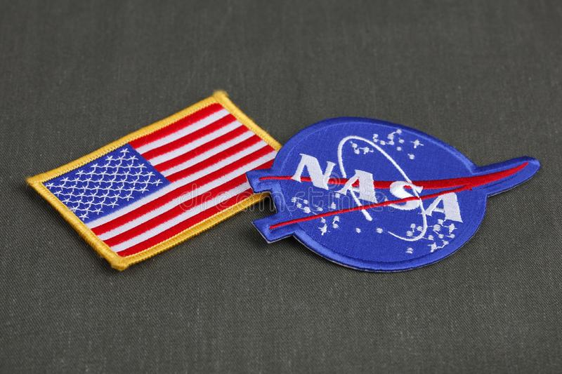 15 March 2018 - The National Aeronautics and Space Administration (NASA) emblem patch and US Flag patch on green uniform stock photos