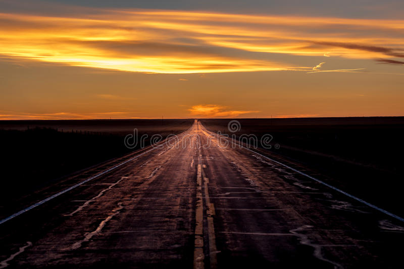 MARCH 8, 2017, NEBRASKA - Sunset over Rural Farm Country Road with pickup truck driving by row of powerlines royalty free stock images