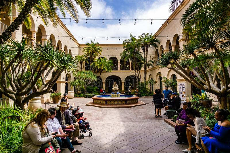 March 19, 2019 San Diego / CA / USA - People sitting in the Prado interior courtyard in Balboa Park stock photo