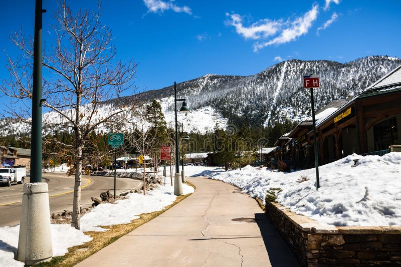 March 23, 2018 South Lake Tahoe / CA / USA - Paved sidewalk cleared of snow on a sunny day royalty free stock photography