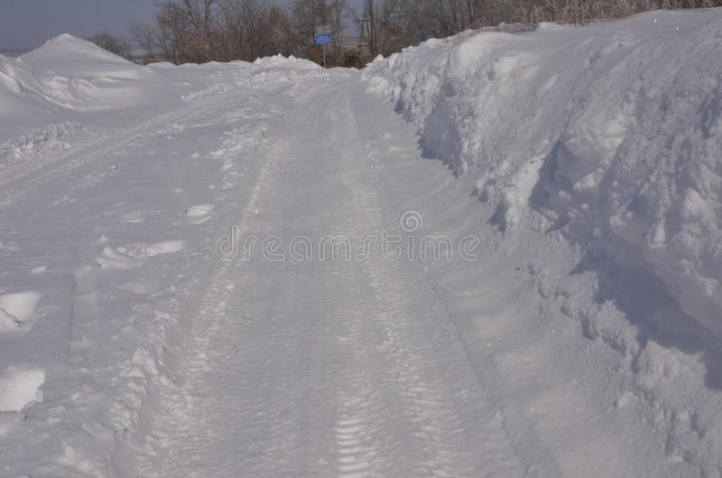 March. Sparkling snow in large drifts lying on the roadside stock photography