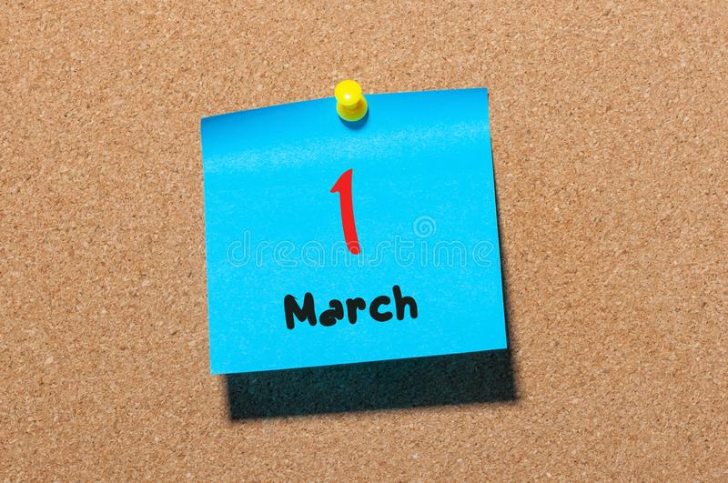 March 1st. Day 1 of month, calendar on cork notice board background. Spring time, empty space for text stock image