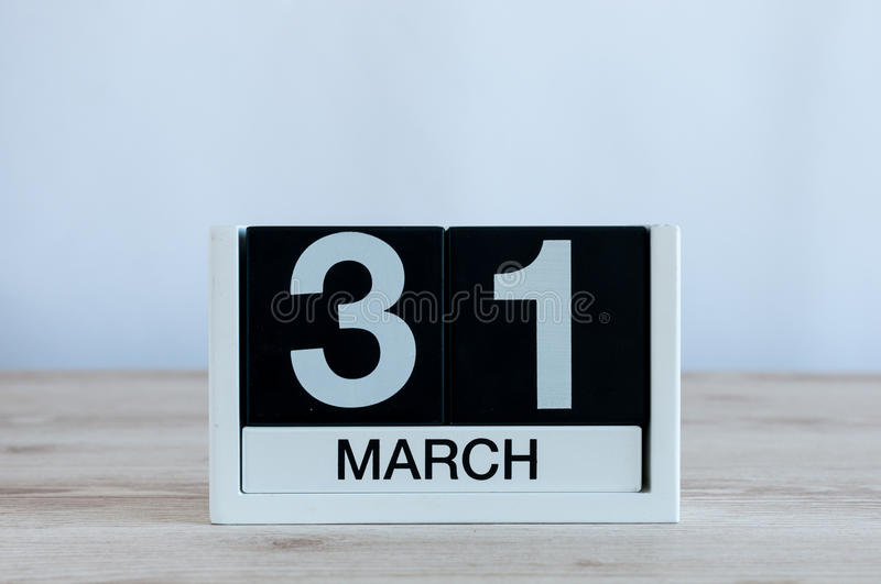 March 31st. Day 31 of month, everyday calendar on wooden table background. Spring time, empty space for text royalty free stock images