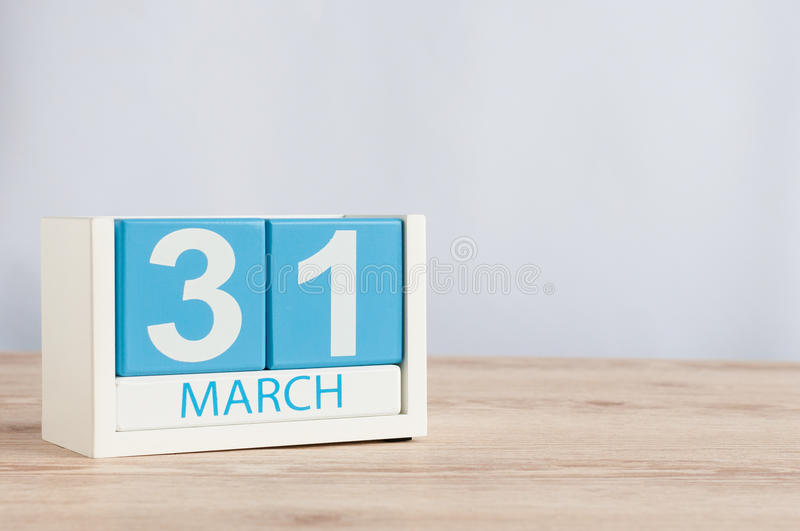 March 31st. Day 31 of month, wooden color calendar on table background. Spring time, empty space for text royalty free stock photo