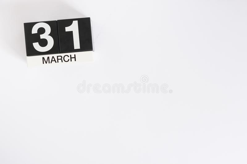 March 31st. Day 31 of month, wooden color calendar on white background. Spring time, empty space for text royalty free stock photography