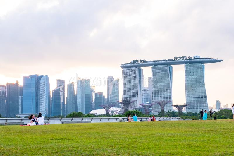 2019 March 1st, Singapore, Marina Barrage - Panorama view of the city buildings and people doing their activities at sunset stock photos