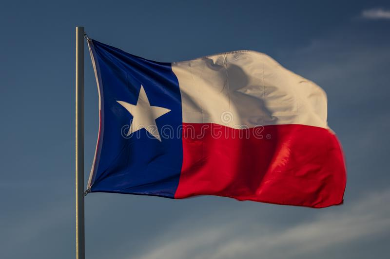 MARCH 6, 2018 - TEXAS STATE FLAG - Texas Lone Star flag stands out against a cloudless blue. Shape, Texas stock photos