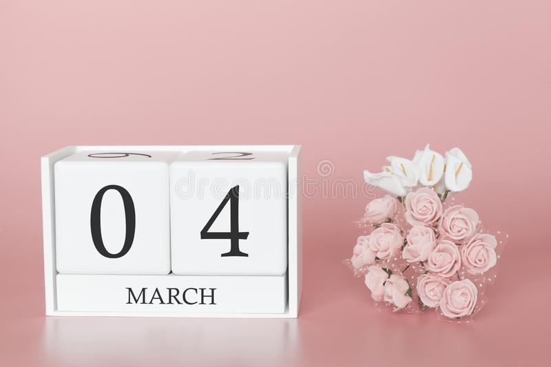 March 04th. Day 4 of month. Calendar cube on modern pink background, concept of bussines and an importent event royalty free stock photo