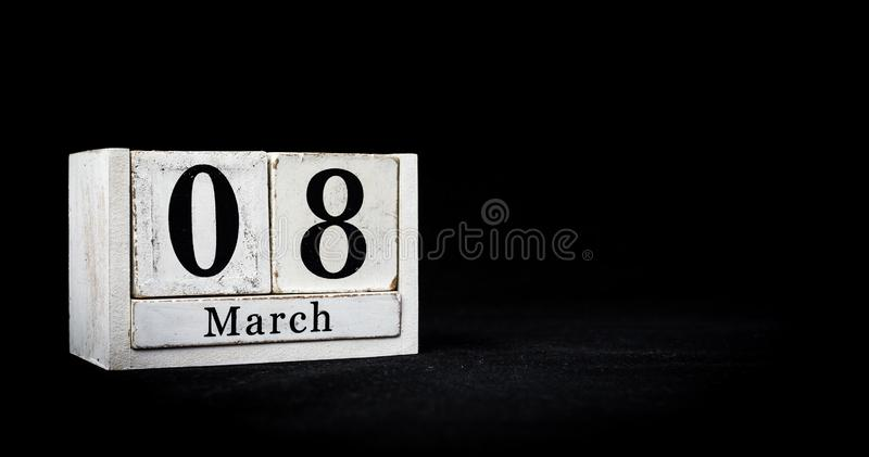 March 8th, Eighth of March, Day 8 of month March - white calendar blocks on black textured background with empty space for text stock photos