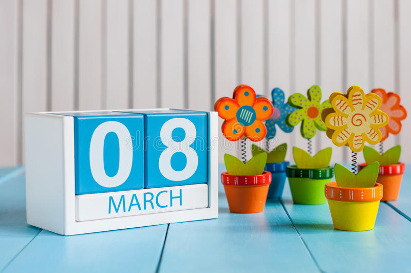 March 8th, save the date blue block calendar for International Women's Day, march 8, decorated with flower, vase.  stock photos