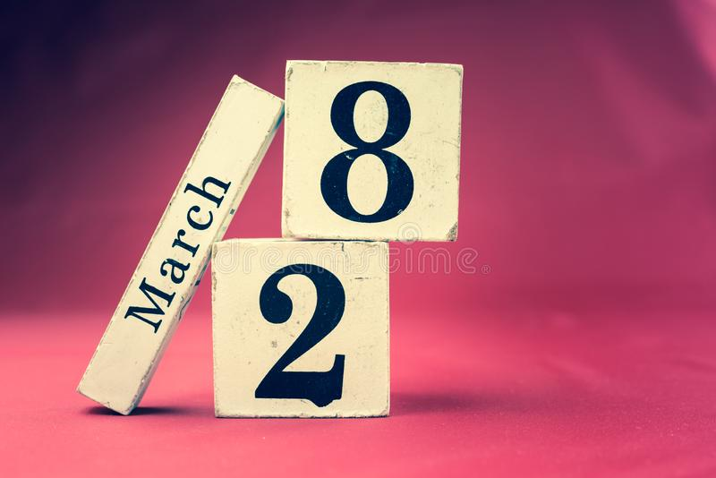 March 28th, Twenty-eighth of March, Day 28 of month March - vintage wooden calendar blocks on maroon background with empty space. For text stock images