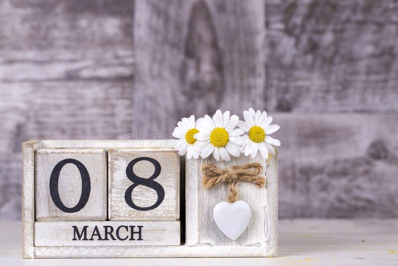 March 8th wooden calendar, World Woman`s Day.  stock photos