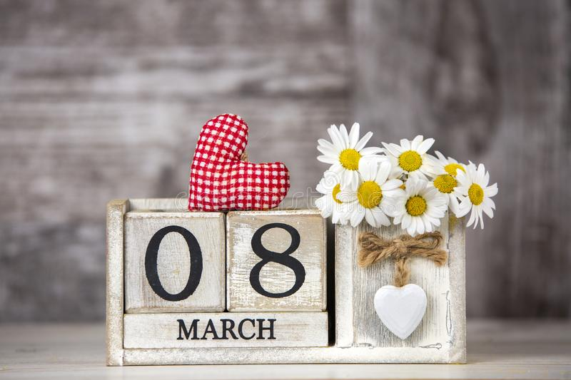 March 8th wooden calendar, World Woman`s Day.  stock photography