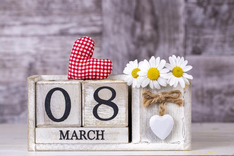 March 8th wooden calendar, World Woman`s Day.  royalty free stock photos