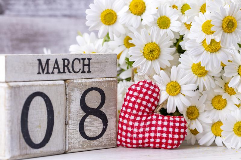 March 8th wooden calendar, World Woman`s Day.  royalty free stock images