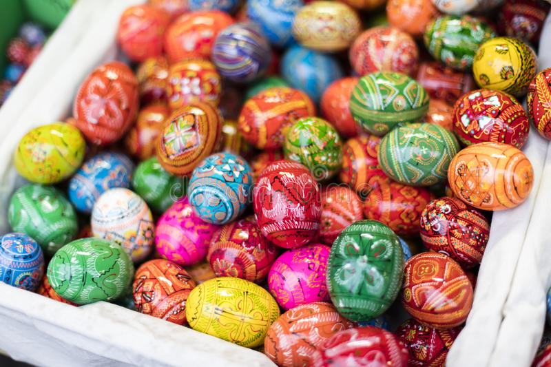 MARCH 25, 2016: Traditional wooden decorative eggs sold at traditional Easter markets on Old Towns Square in Prague stock photography