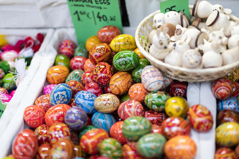 MARCH 25, 2016: Traditional wooden decorative eggs sold at traditional Easter markets on Old Towns Square in Prague stock photo