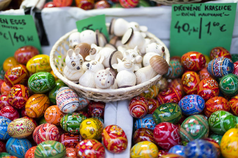MARCH 25, 2016: Traditional wooden decorative eggs sold at traditional Easter markets on Old Towns Square in Prague royalty free stock photography
