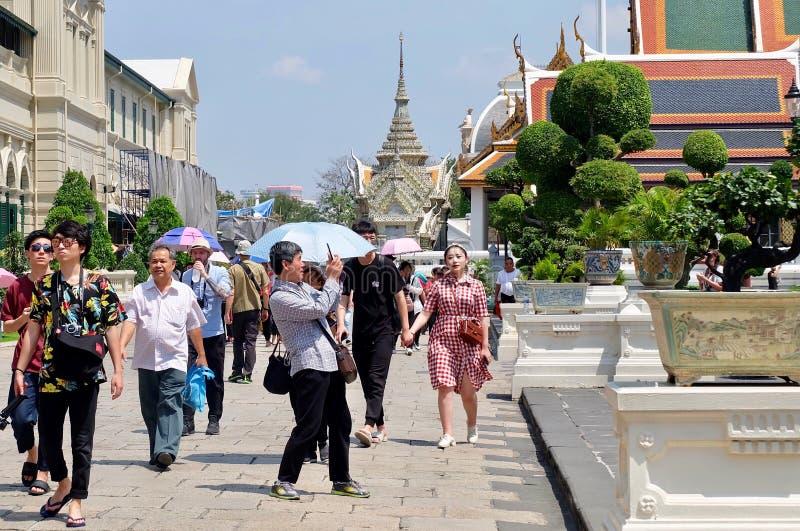 Travelers at Chakri Maha Prasat Throne Hall in Bangkok, Thailand stock photo