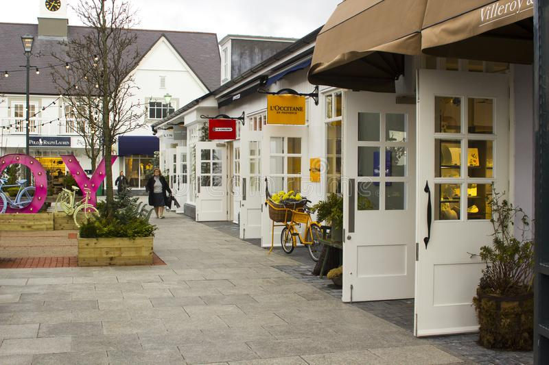 A woman laden with carrier bags while enjoying some retail therapy at the up market Kildare Village shopping outlet in County Kil. 16 March 2018 A woman laden royalty free stock image