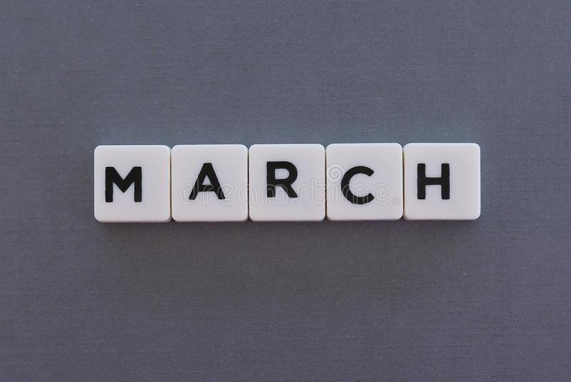March word made of square letter word on grey background. Month time day date monthly calendar concept text spring reminder design number hello diary holiday royalty free stock photography