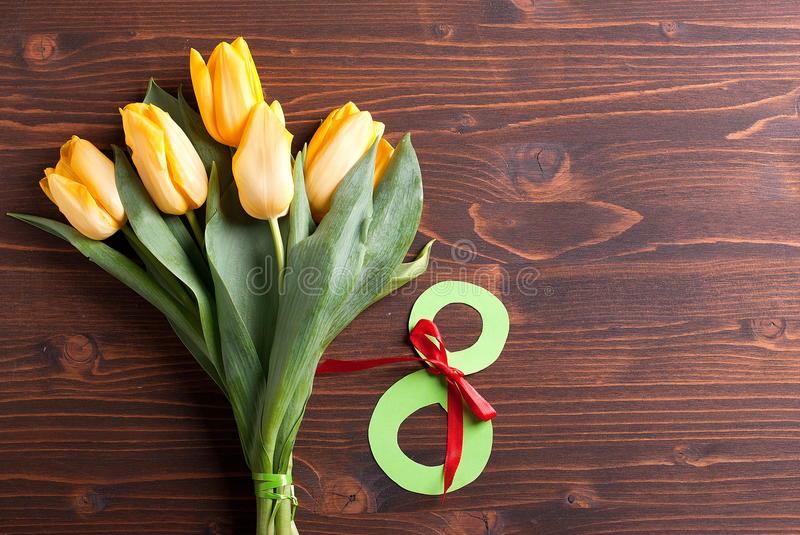 March 8 and yellow tulips stock image