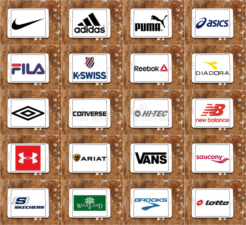 Marche e logos famosi superiori delle società degli abiti sportivi illustrazione di stock