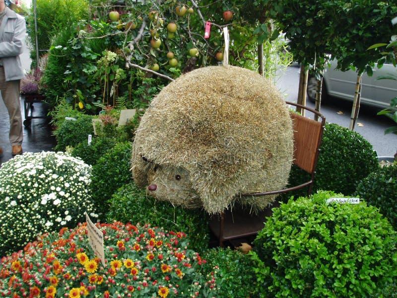 Marche fleuri in Paris. Original sculpture made from grass at the floral market in Paris stock photos