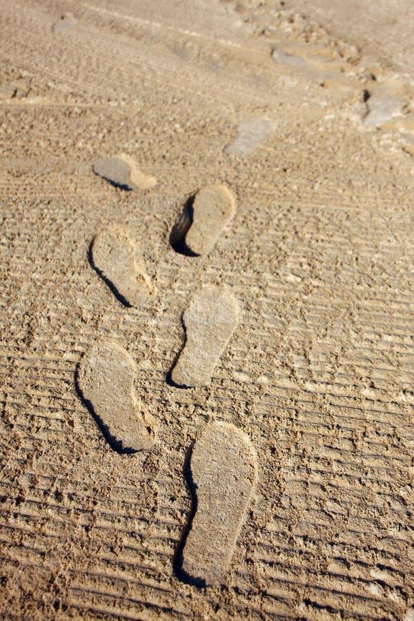 marchepied dans le sable photos stock