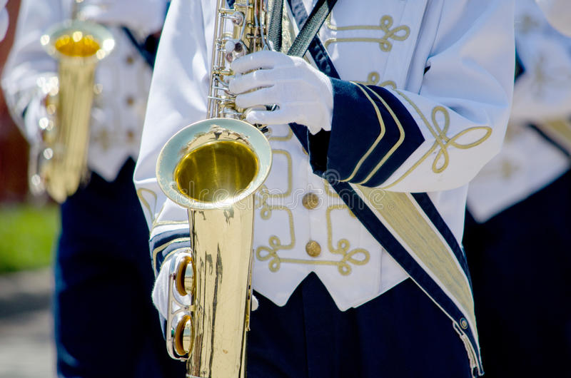 Marching band playing saxaphones stock image