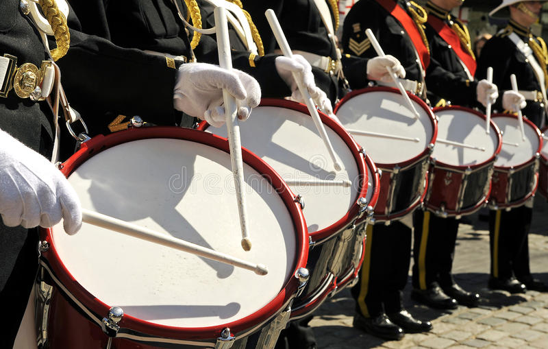 Marching drummers. Five marching drummers playing in a row stock photo