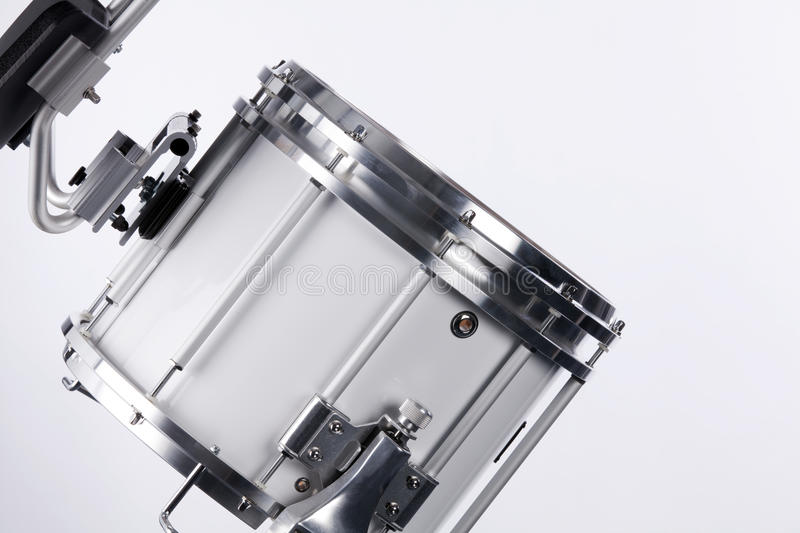 Marching Field Drum Isolated On White. A white marching field drum and carrier isolated against a white background royalty free stock image