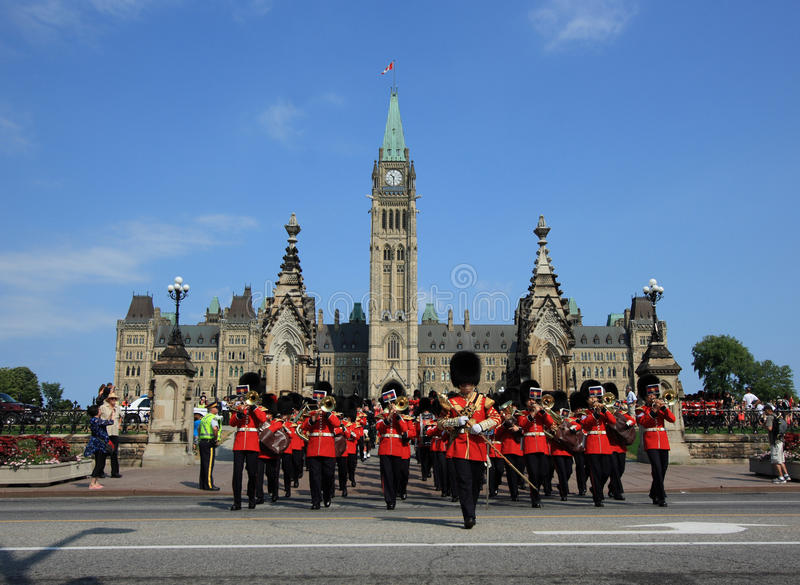 Marching Guards with Parliament Buildings stock images