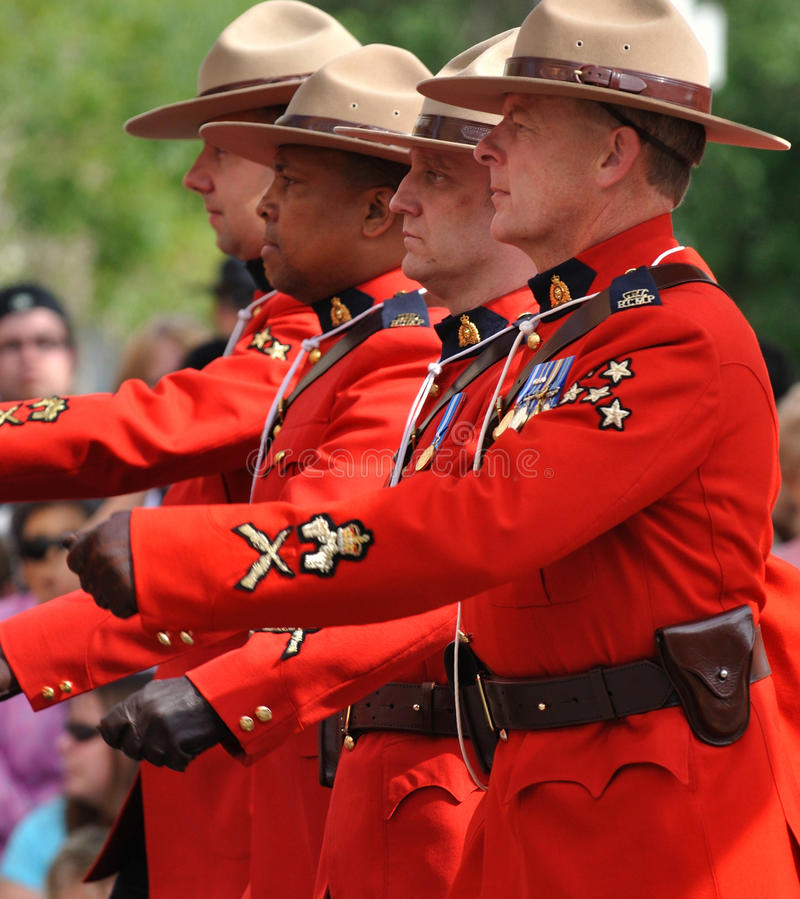Marching RCMP. Royal Canadian Mounted Police marching in Edmonton's capital Ex parade royalty free stock images