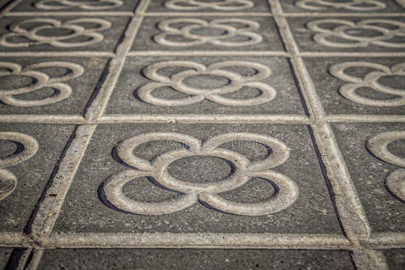 Marciapiedi classici delle mattonelle della città di Barcellona fotografia stock libera da diritti