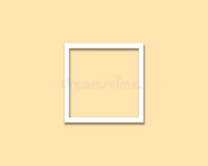 Marco blanco en blanco de la foto en fondo amarillo de color en colores pastel fotos de archivo libres de regalías
