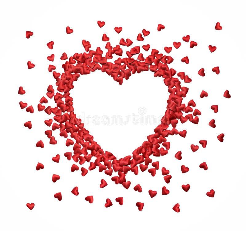 Marco de la forma del corazón hecho de pequeños corazones del confeti fotografía de archivo
