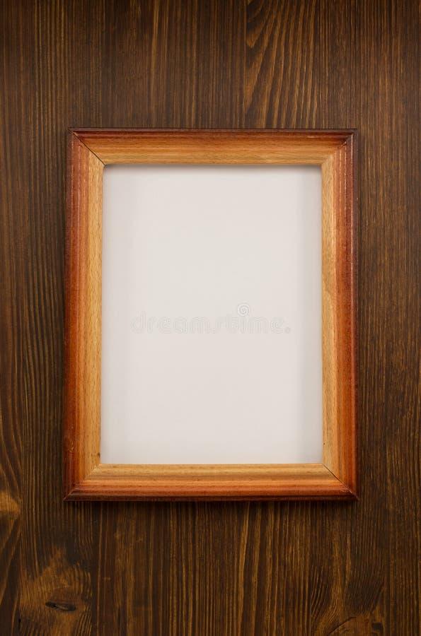 Marco de la foto en la madera fotografía de archivo libre de regalías