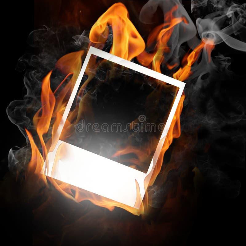 Marco de la foto en llama imagenes de archivo