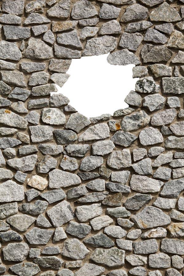 Marco de la pared de piedra con el pequeño agujero vacío foto de archivo