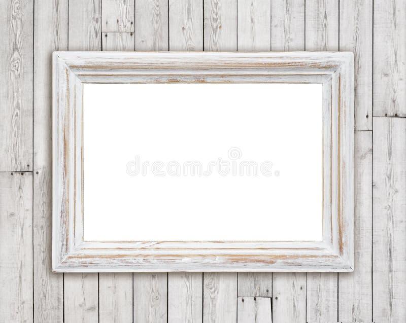 Marco de madera blanqueado en fondo de la pared del tablón del vintage fotos de archivo