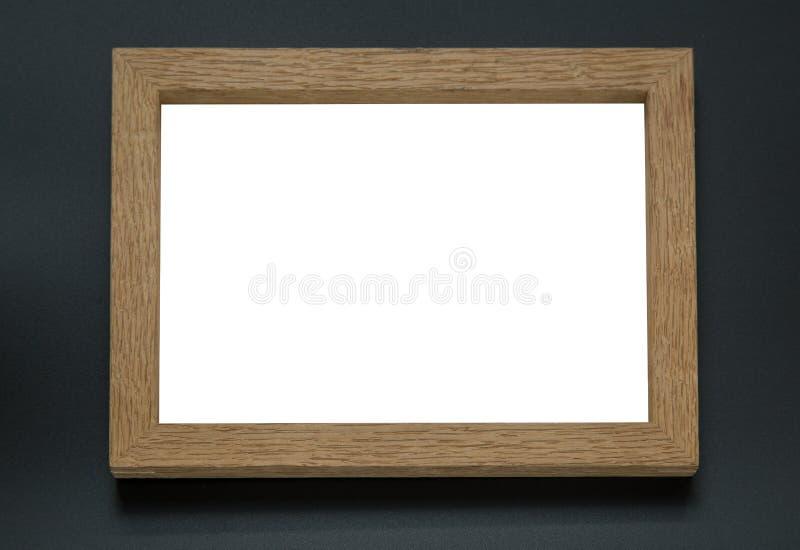Marco de madera en blanco de la foto en fondo negro fotos de archivo libres de regalías