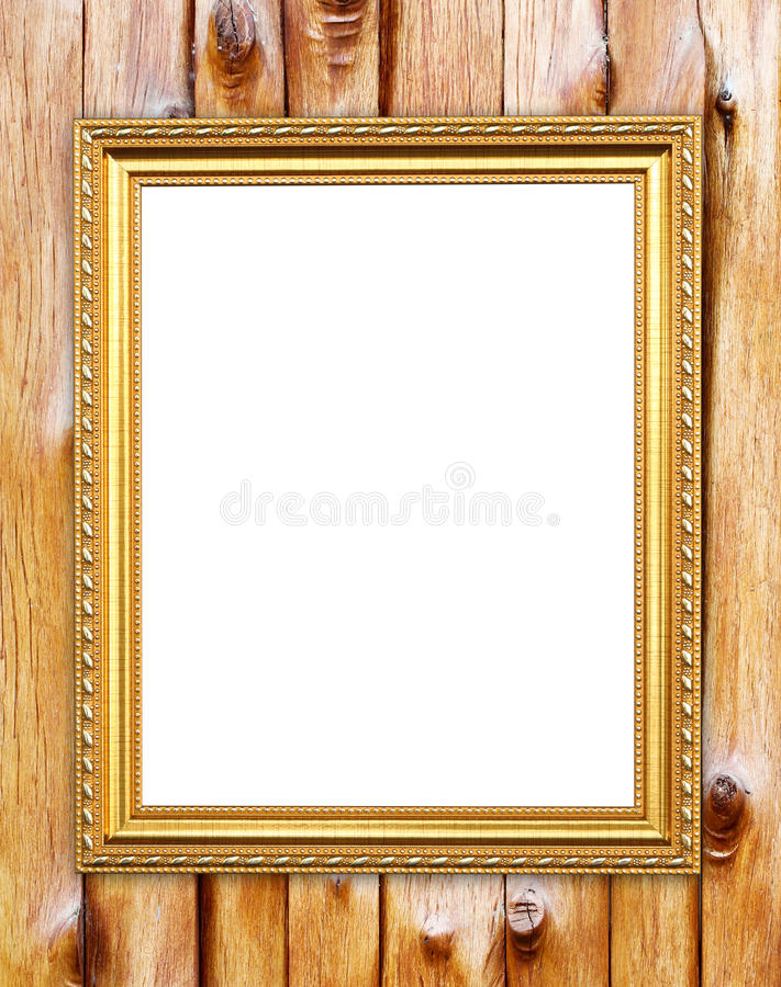 Marco de oro en blanco en la pared de madera foto de archivo