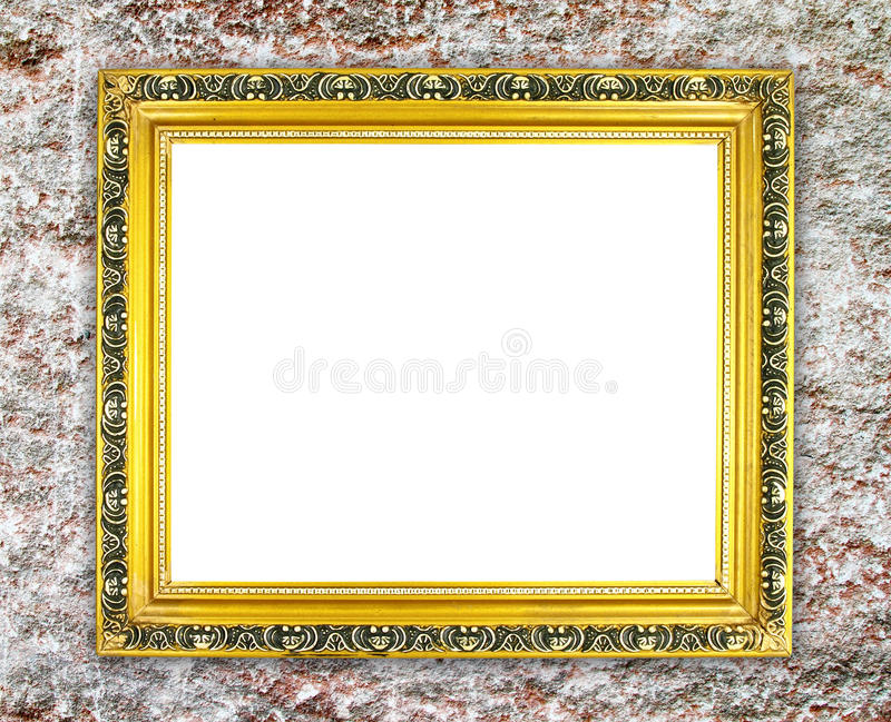 Marco de oro en blanco en la pared de piedra antigua imagen de archivo