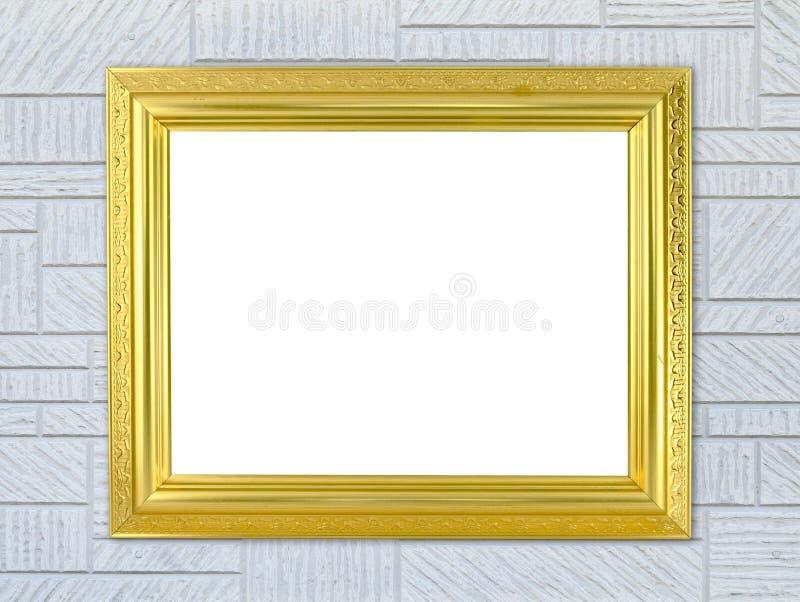 Marco de oro en blanco en la pared moderna imagenes de archivo