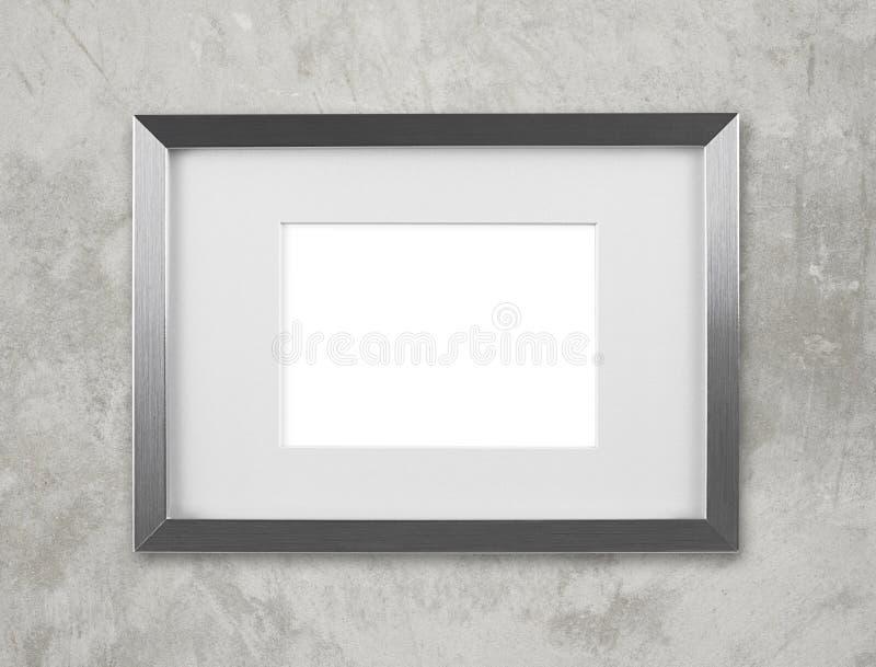 Marco de plata en blanco en la pared fotografía de archivo