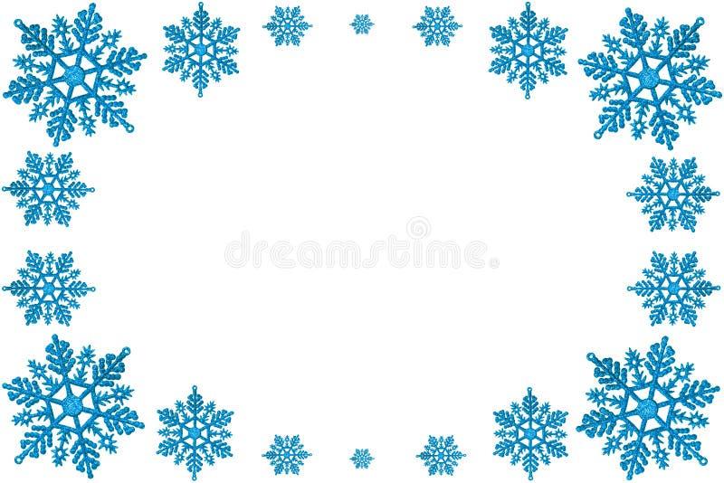 Marco decorativo de la Navidad de copos de nieve azules. foto de archivo libre de regalías