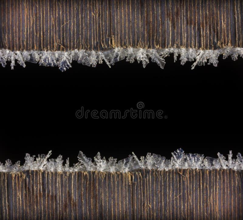 Marco del fondo del Año Nuevo de la Navidad de las vacaciones de invierno de la helada macra de la foto en tablones de madera vie foto de archivo