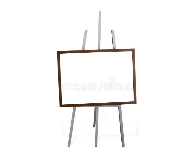 Marco en blanco del arte, caballete de madera, vista delantera fotos de archivo